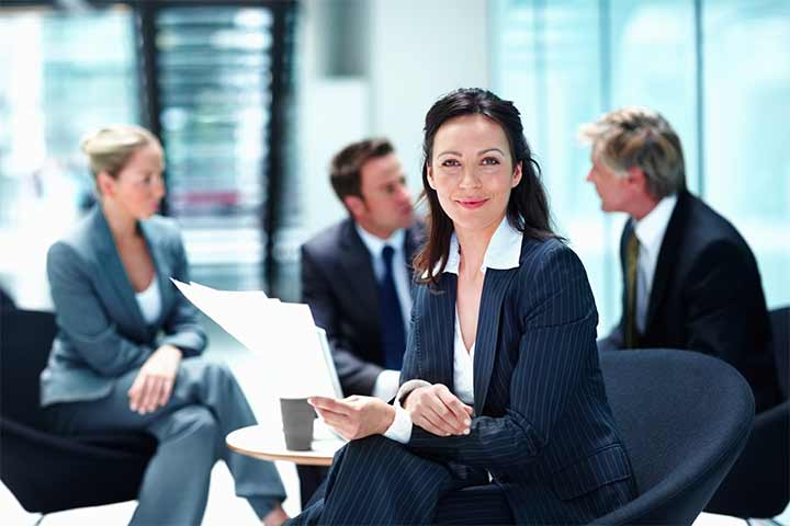 Photo of a woman at a business meeting